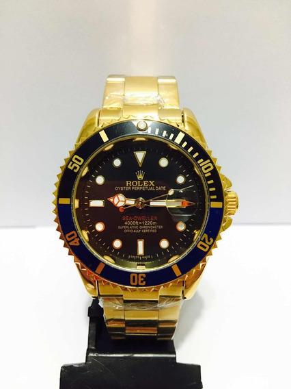 Relógio Modelo Sub Em Aço Gold Com Catraca Preta E Azul