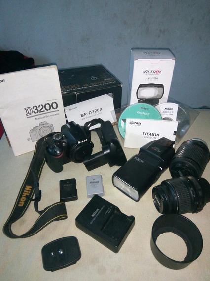 Nikon D3200+lentes 18 55 E 55 200+grip+2baterias+flash+tripe