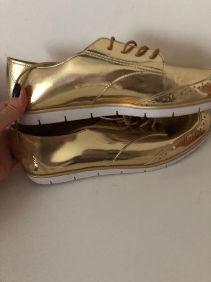 Tênis Dourado