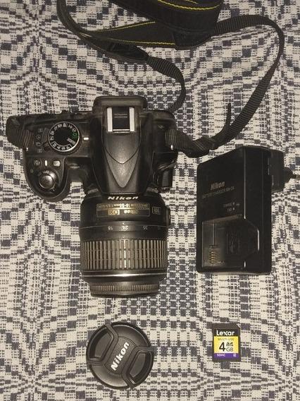 Câmera Nikon D3100, Lente 18-55mm, Carregador.