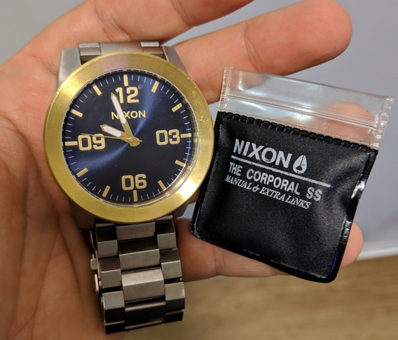 Relógio Nixon Corporal Ss Prata E Dourado - Novo
