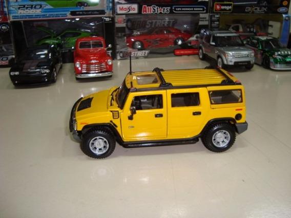 Miniatura Hummer H2 1/27 Maisto Amarelo #9921