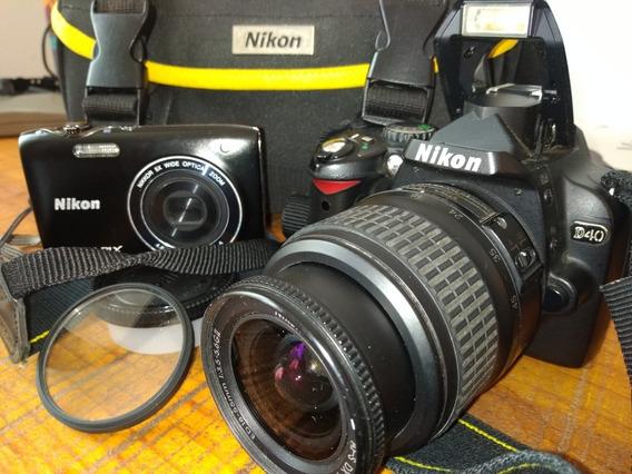 Nikon D40 + Case Nikon Original + Nikon Coolpix S3100