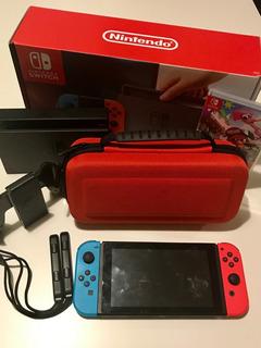 Consola Nintendo Switch 32gb Neon Americana 2 Juegos Y Funda