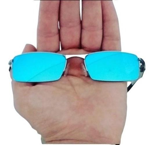 Óculos Oakley Lupa Vilao Mandrak Prata Lente Azul Bebe