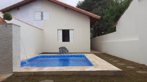 Imagem 1 de 14 de Casa 1km Do Mar Com Piscina E 2 Dorm Com 150m² 6989