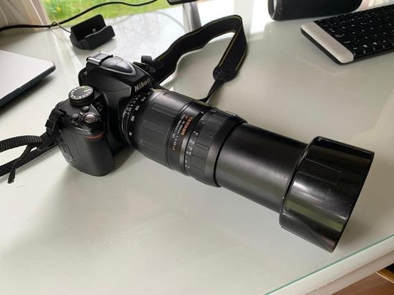 Cámara Digital Nikon D3000 Y Lente Tamron 75 300
