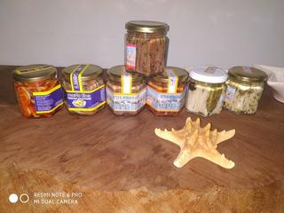 Anchoas En Aceite, Boquerones Y Calamares En Conserva