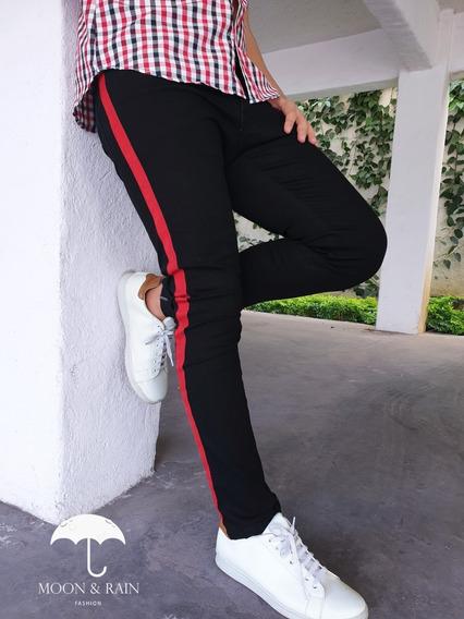 Jeans Skinny Oscuro Desgarrado Franja Latera