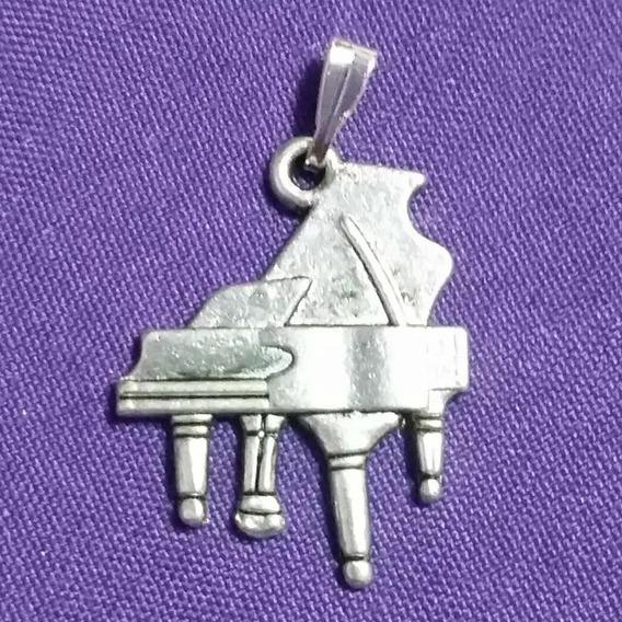 Dije Figura De Piano En Plata Tibetana.