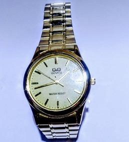 Relógio Q&q Dourado Social - Q712-010y