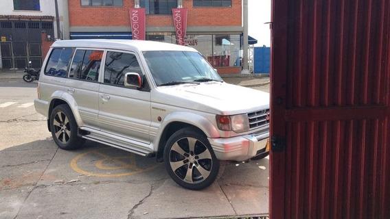 Mitshubishi V6 ,3000cc,5 Puertas, Gris Plata