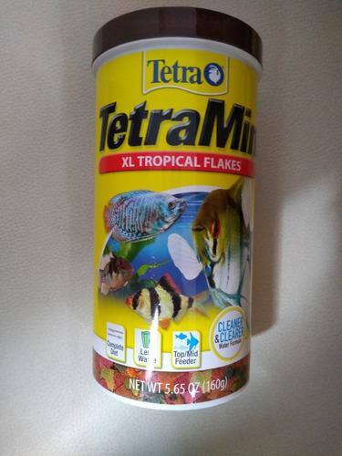 Imagen 1 de 1 de Tetra Tetramin Xl Tropical Flakes 160 G. Alimento Peces Nutricion Dieta Equilibrada