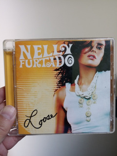 Cd Nelly Furtado Sus Temas En Ingles Y Español