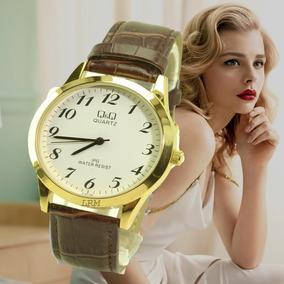 Relógio Feminino Dourado Fundo Branco Couro Q&q Promoção.