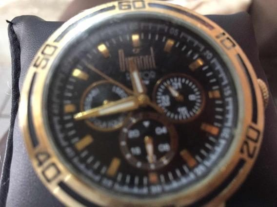 Relógio Dumond Dourado