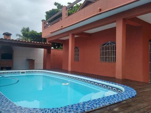 Imagem 1 de 14 de Casa Com Piscina Na Praia 3 Dormitórios 2 Suítes 7865