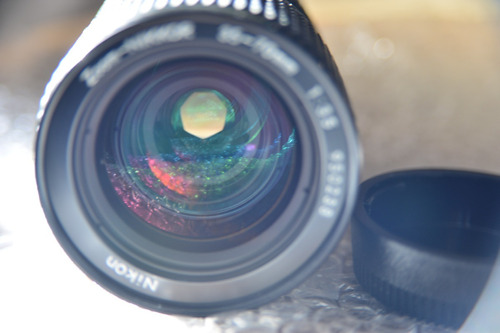 Lente Nikon Nikkor 24-50mm F/3.3-4.5 Af + Parasol Hb-3