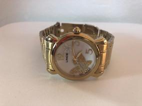 Relógio De Aço Dourado Com Strass, Fundo Branco, Marca Lince