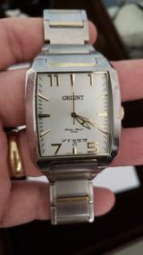 Relógio Oriente Aço Escovado Com Detalhes Banhado A Ouro