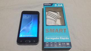 Celular Samsung J1 120h + Carregador Funcionando (leia)