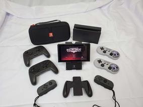 Nintendo Switch + 4 Controles + Acessórios