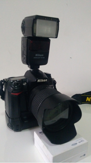Nikon D7000 + Flash Sb600 + Batery Gripp