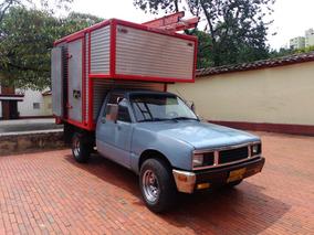 Camioneta Luv Kb21 Año 87. Furgón En Aluminio Con Capacete.