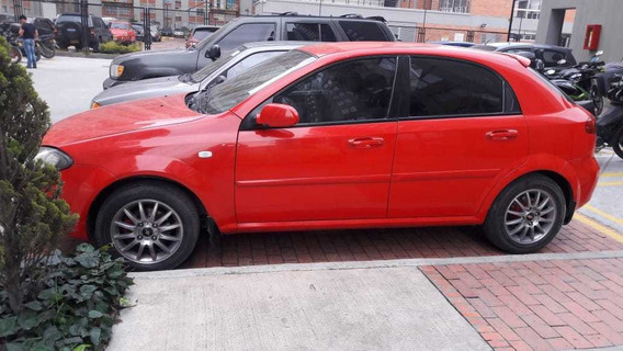 # Chevrolet Optra Hatchback Color Rojo # Precio $negociable