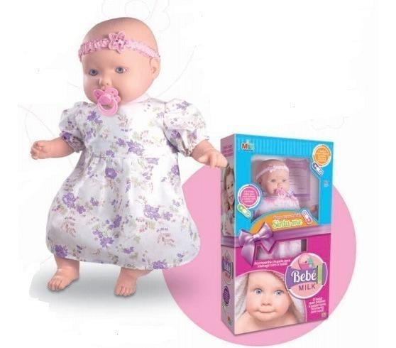 Boneca Bebê Milk Com Chupeta , Laço E Vestido Super Fofinha