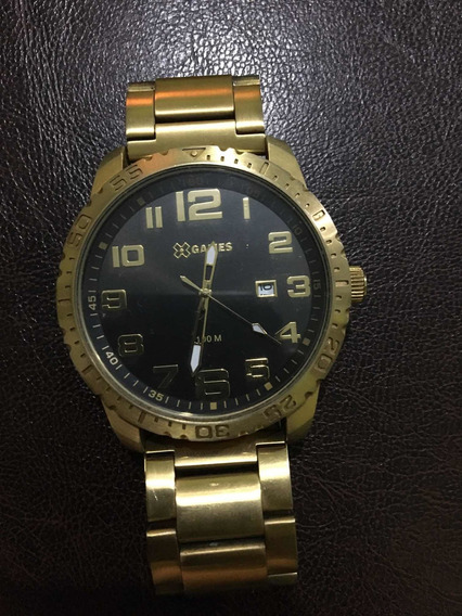 Relógio Xgames Dourado.