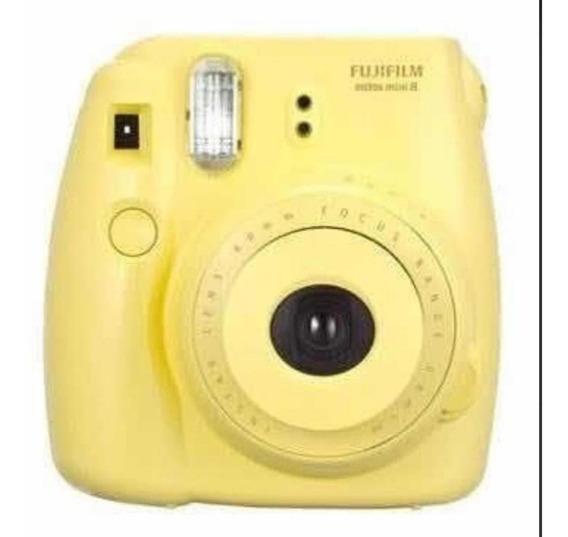 Camera Polaroid Amarela.