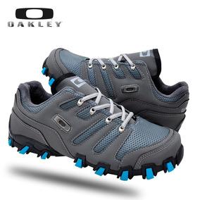 95e3a34eebd Tenis Oakley Caveirão Cinza E Azul Masculino - Calçados