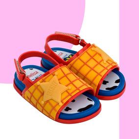 Mini Melissa Beach Slide + Toy Story Original + Nf