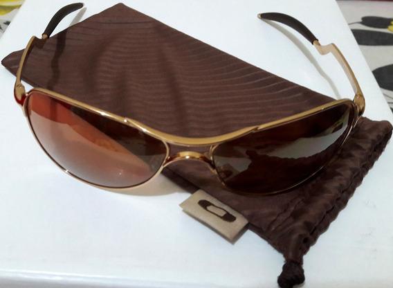 Oculos Oakley Warden Dourado