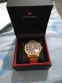 Relógio Technos Original Dourado Com Boné De Brinde.