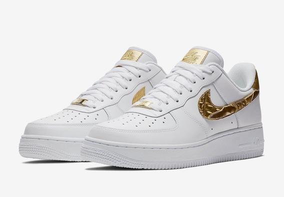 zapatillas nike blancas y doradas