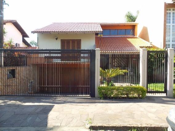 Casa Em Tristeza Com 4 Dormitórios - Mi15872