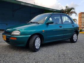 Mazda 121 1998 Verde 1.3l Aire Acond Muy Buen Estado