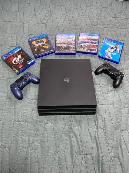 Playstation 4k Pro 1tb Ps4 2 Controles 6 Jogos + Nf Garantia