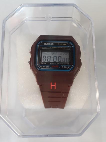 Relógio Unissex Marrom C/alarme/luz Interna.