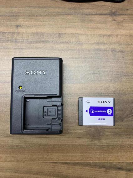 1 Carregador De Bateria Sony Bc-csd + 1 Bateria Np-fd1