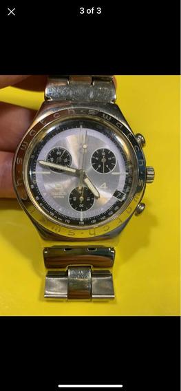 Relógio Prata Com Fundo Lilás Swatch
