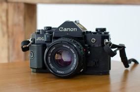 Canon A-1 (revisada) + Lente 50mm F1.8 (com Haze)