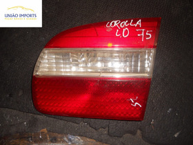 Lanterna Da Tampa Toyota Corolla 95/02 L/d (detalhe) Nº75