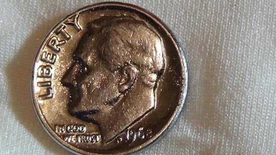 Moneda.de.10.centavos.americana.con.errorde.año.1968.sin.mar