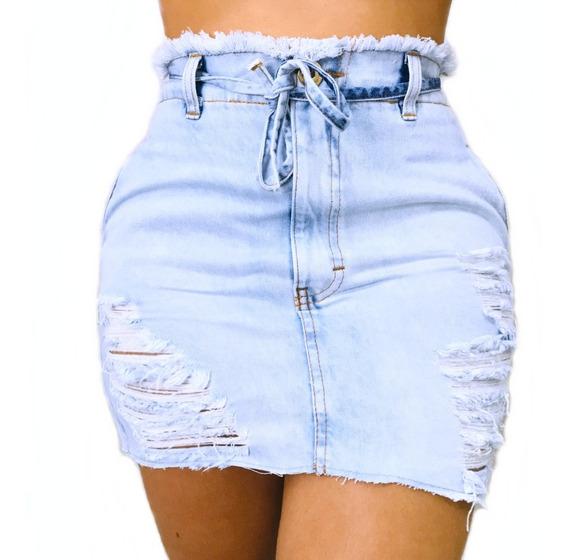 Saia Jeans Clochard Cintura Alta Botão Desfiada Curta Laço