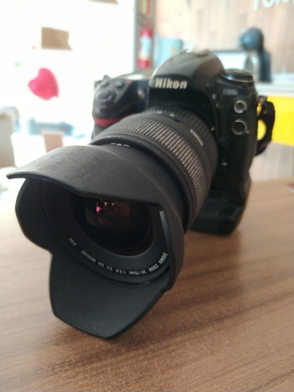 Nikon D300s + Grip + Lente 24-70mm 2.8 Sigma.