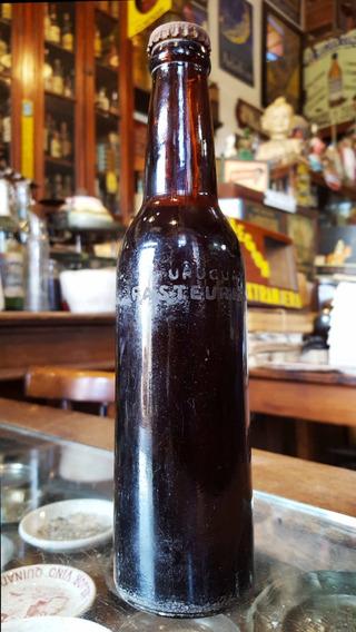 Antigua Botella Cerveza Uruguay (llena). 28188
