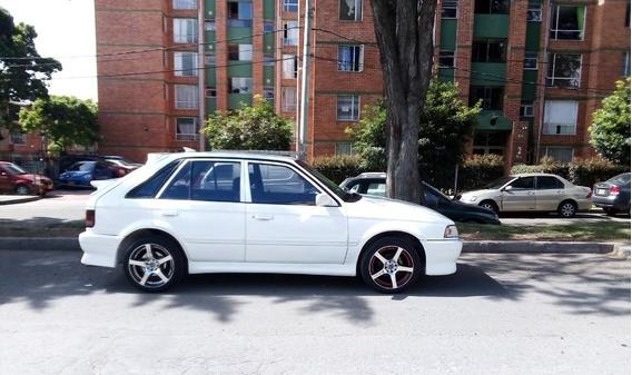 Mazda 323 Hbi 1.3 Modelo 1999, Blanco 4 Puertas
